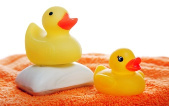 Yellow rubber duckies and a bar of soap